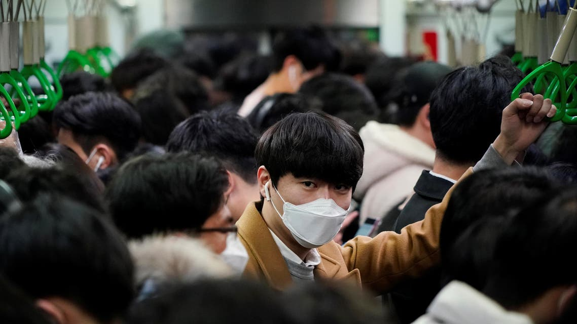 A man wearing a mask as a preventive measure against the coronavirus rides on a train in Seoul. (File photo: Reuters)