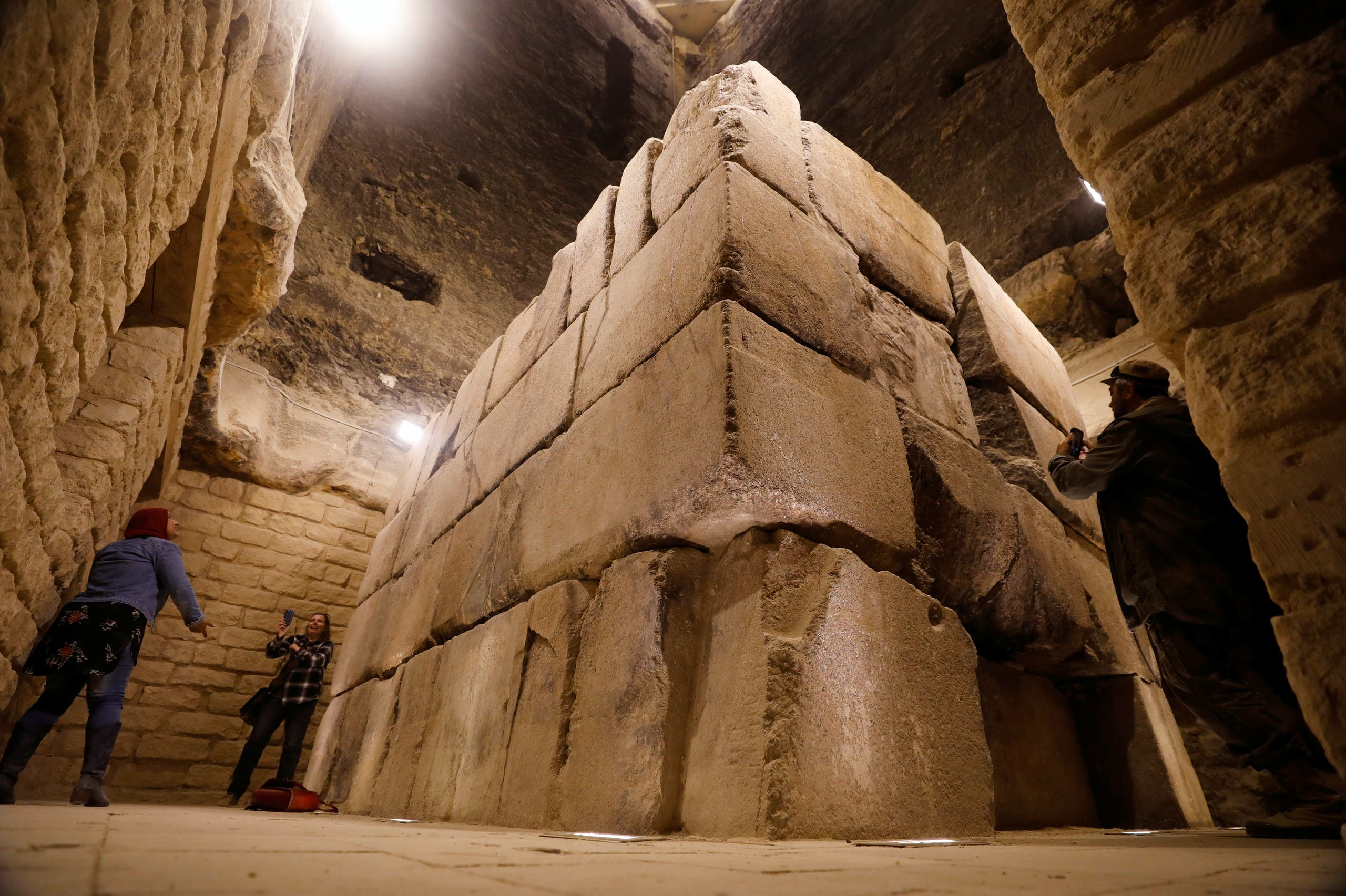 Tourists take pictures at the archaeological site of the standing step pyramid of Saqqara after its renovation, south of Cairo, Egypt March 5, 2020. (Reuters)