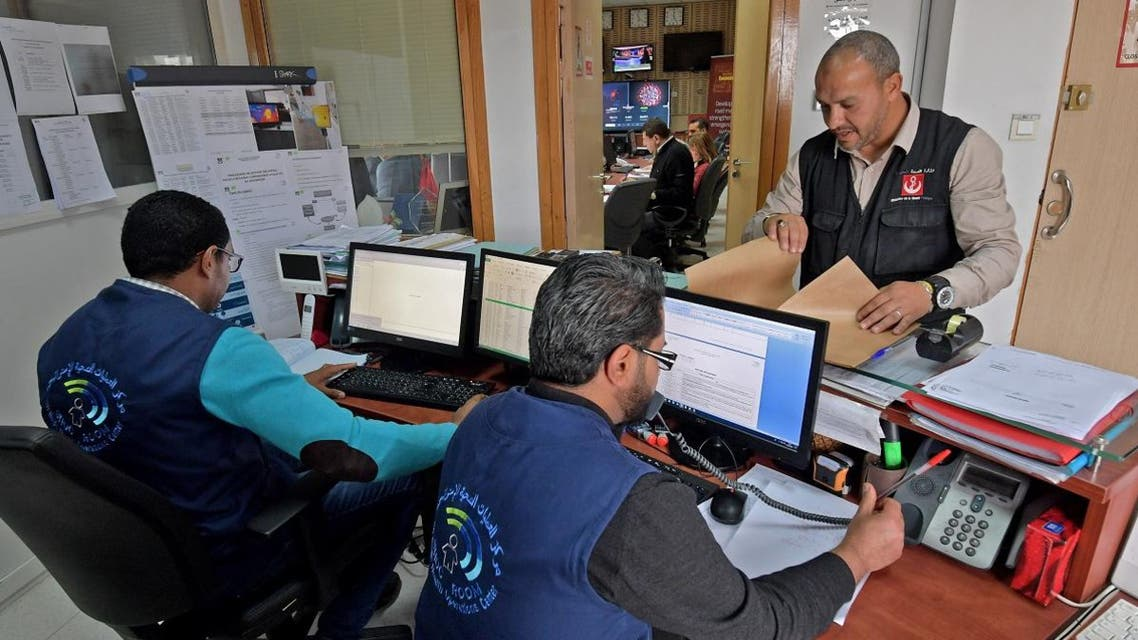 Members of the Tunisian health ministry's COVID-19 coronavirus diease crisis cell respond to phone calls at their premises at the ministry headquarters in the capital Tunis on March 3, 2020. (AFP)