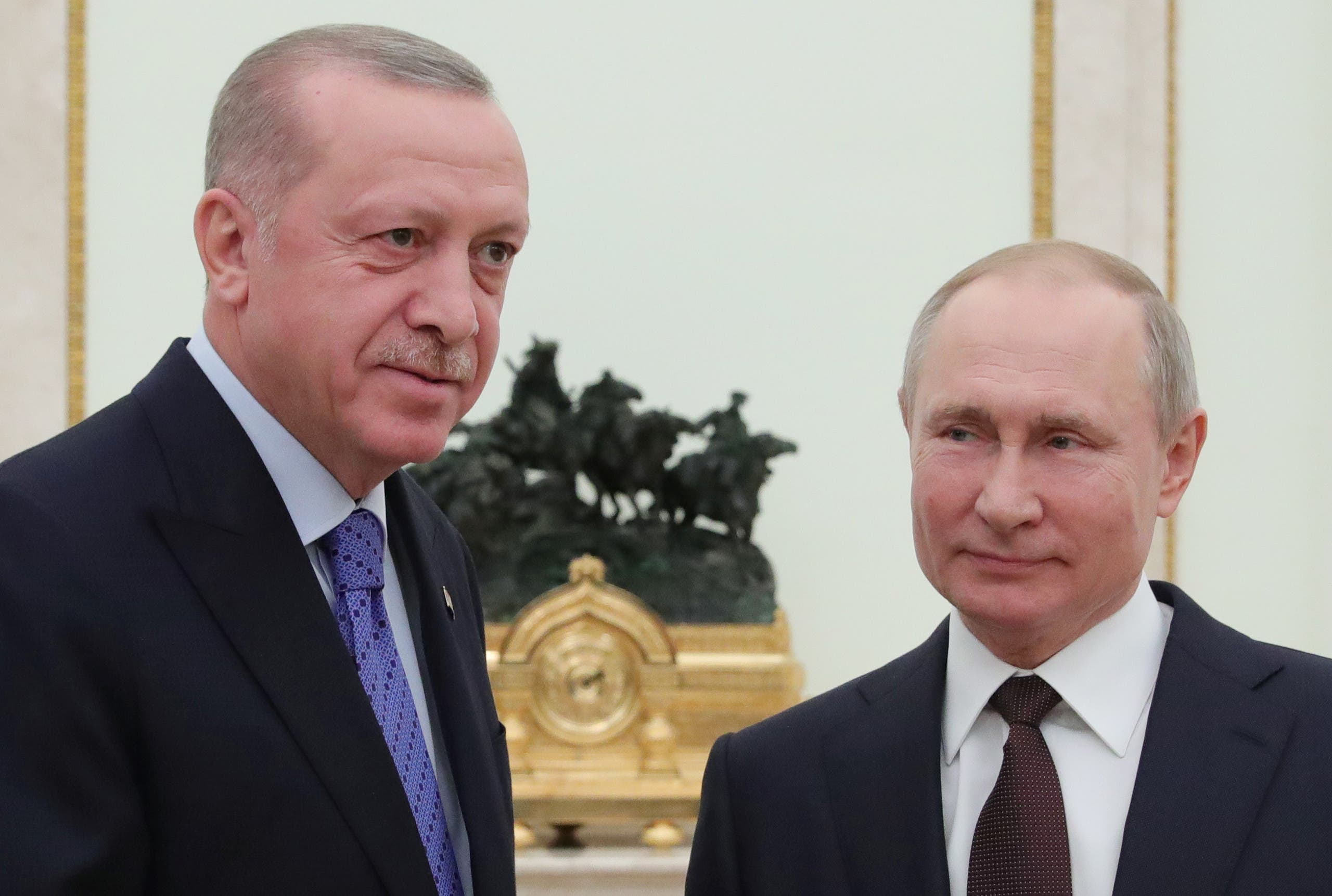 Russian President Vladimir Putin and Turkish President Tayyip Erdogan pose for a photo during a meeting in Moscow, Russia March 5, 2020. (Reuters)