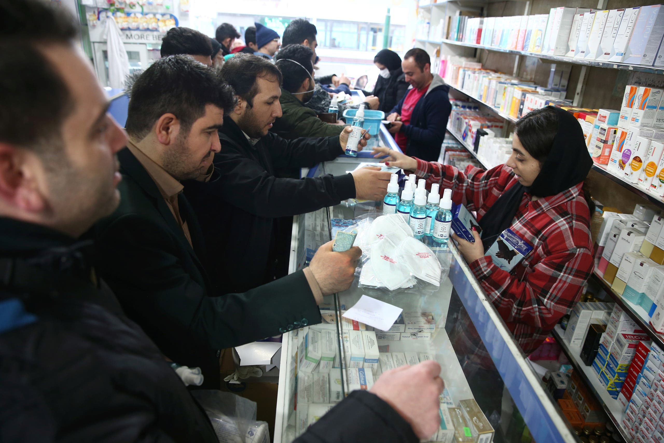 Iranians buy protective masks in a drug store to prevent contracting a coronavirus, in Tehran, Iran, February 20, 2020. (Reuters)