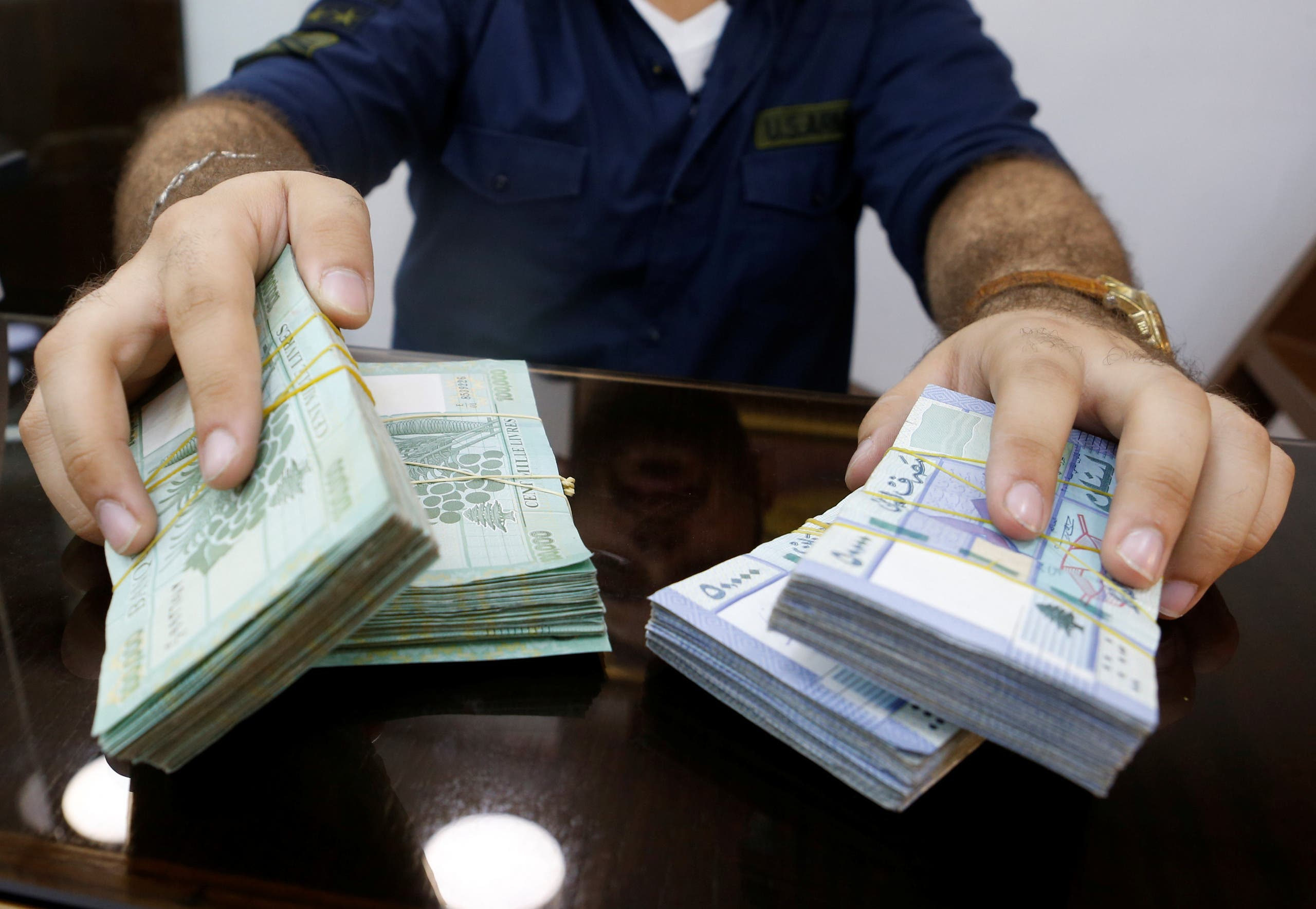 A money exchange vendor displays Lebanese pound banknotes at his shop in Beirut, Lebanon. (File photo: Reuters)