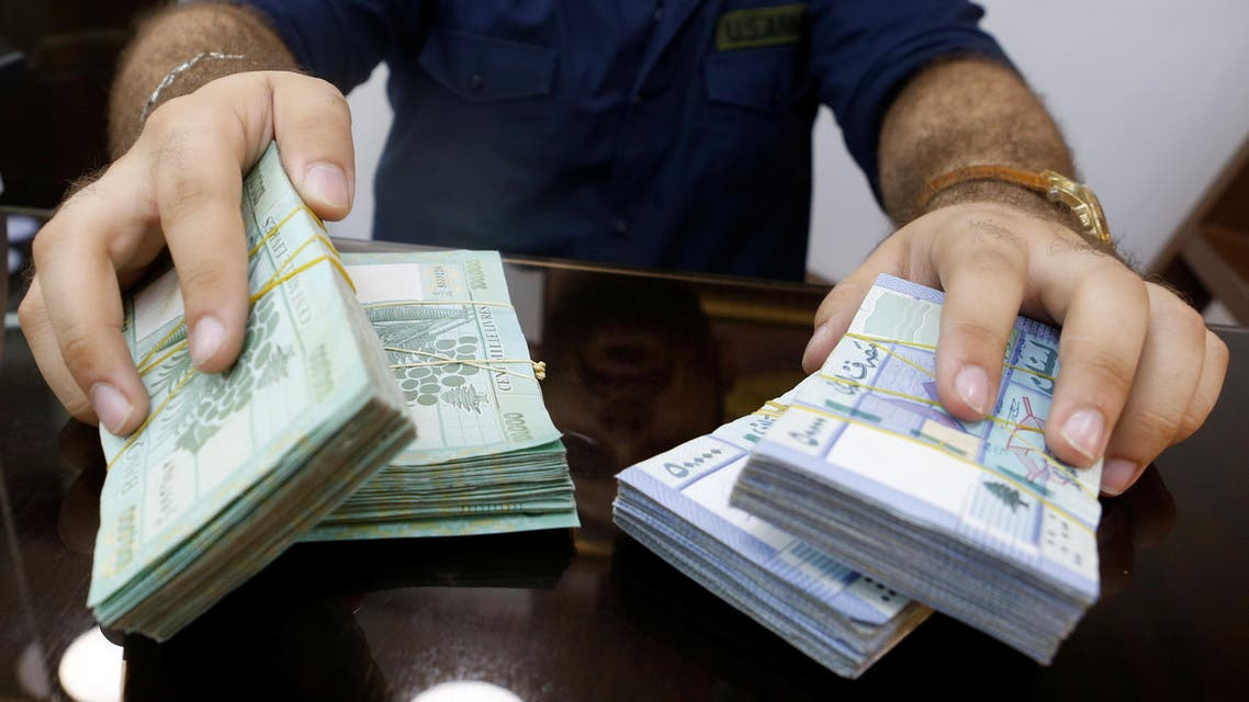 A money exchange vendor displays Lebanese pound banknotes at his shop in Beirut, Lebanon. (Reuters)
