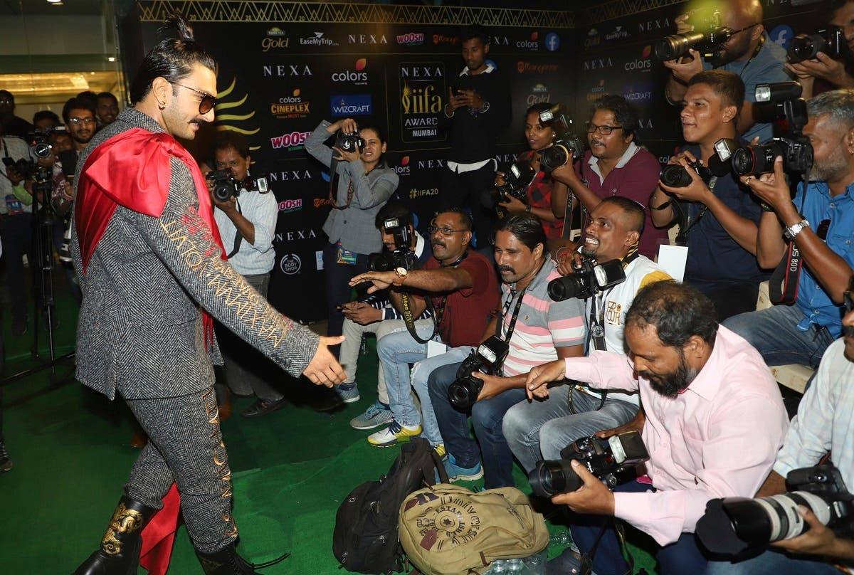 Bollywood actor Ranveer Singh greets photographers as he arrives to attend the 20th International Indian Film Academy (IIFA) awards ceremony in Mumbai, India. (File photo: AP)