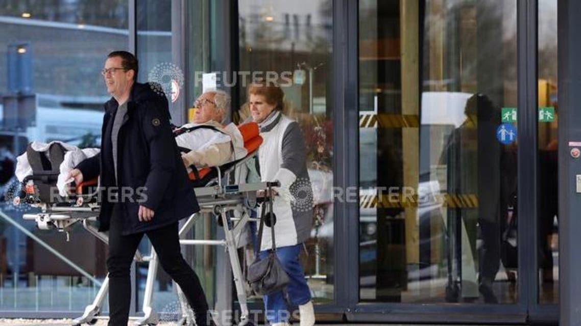 People leave the Elisabeth-TweeSteden Hospital in Tilburg following a case of coronavirus confirmed in the  Netherlands. Reuters