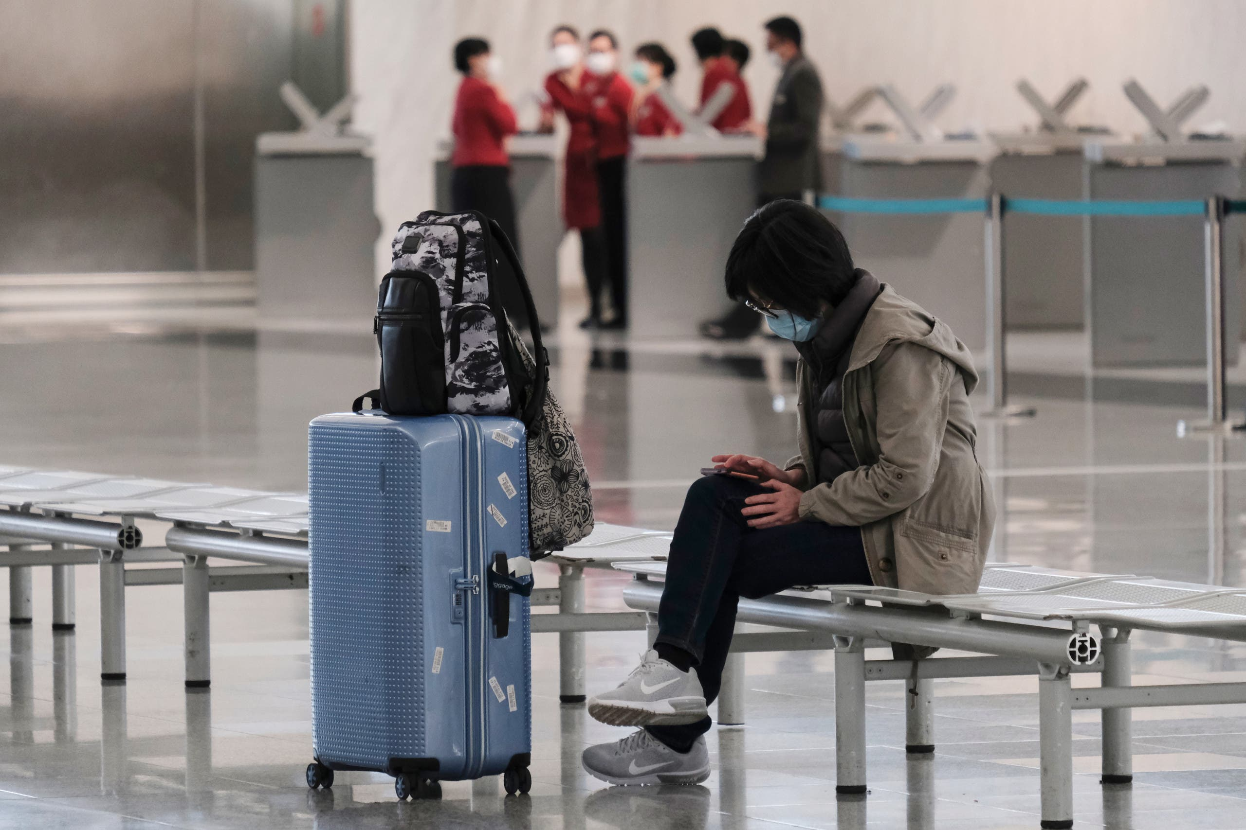 A passenger wears a protective face mask at the airport, following the outbreak of the new coronavirus, in Hong Kong, China, March 5, 2020. (Reuters)