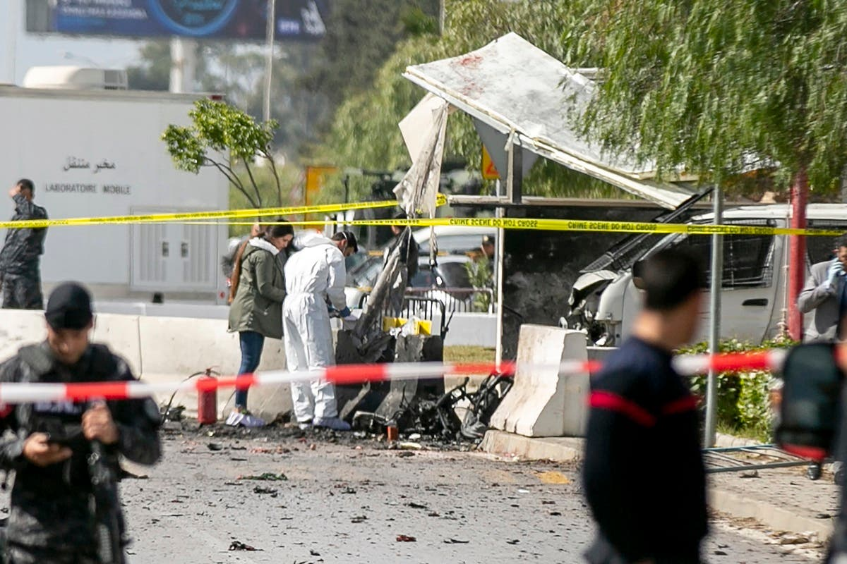 Forensic officers work on a blast site near the US Embassy in Tunis, Friday, March 6, 2020. (AP)