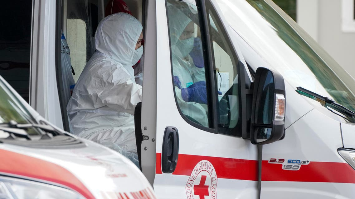 Red Cross personnel prepare for the transport of a Coronavirus patient during a simulation, in Rome on March 6, 2020. (AP)
