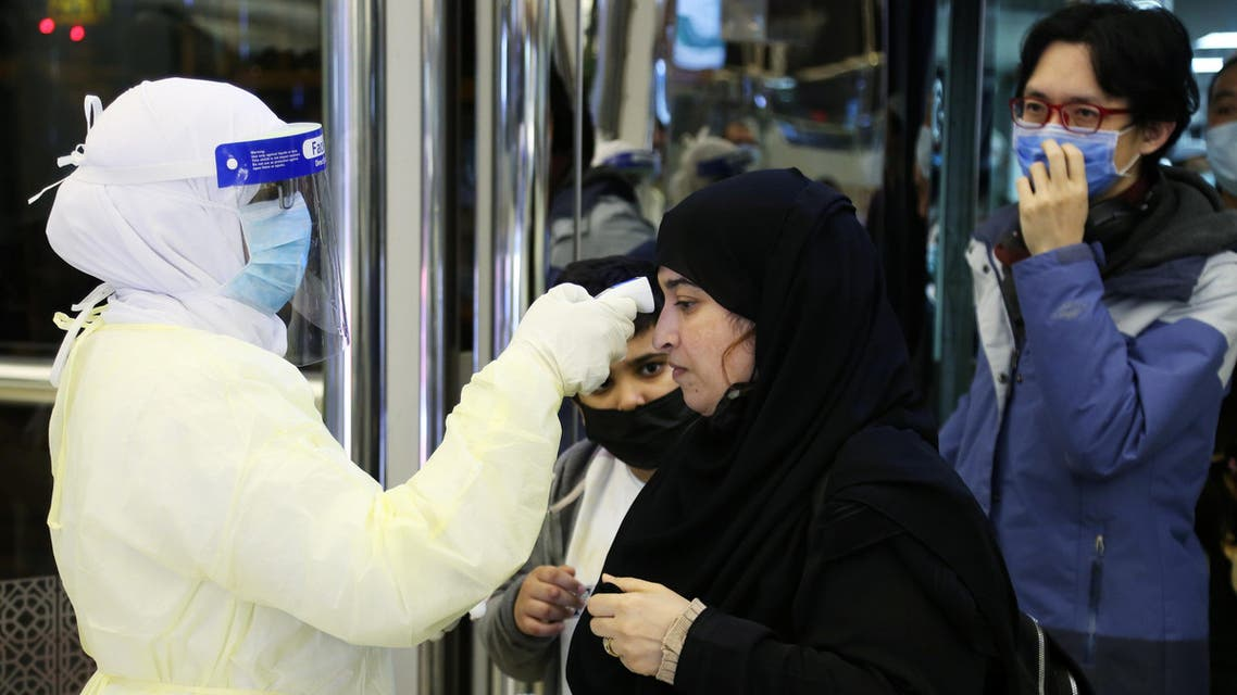 Passengers coming from China wearing masks to prevent coronavirus infection are checked by Saudi Health Ministry employees upon their arrival at King Khalid International Airport, in Riyadh, Saudi Arabia, January 29, 2020. (Reuters)