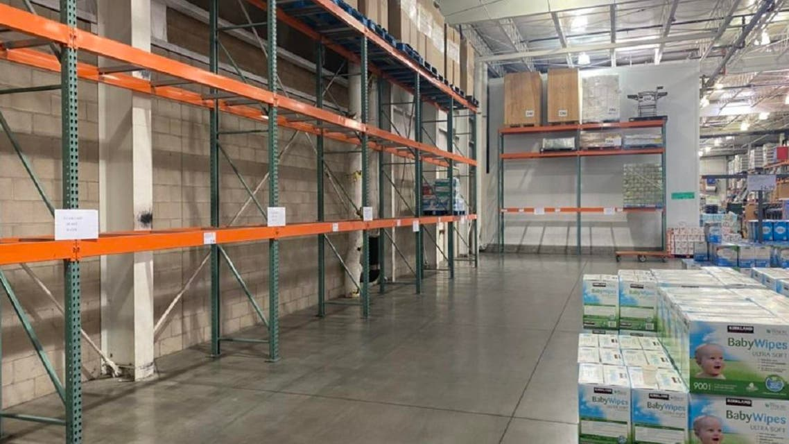 Shelves in a Coscto wearhouse are empty due to people hoarding products amid coronavirus fears. (Twitter)