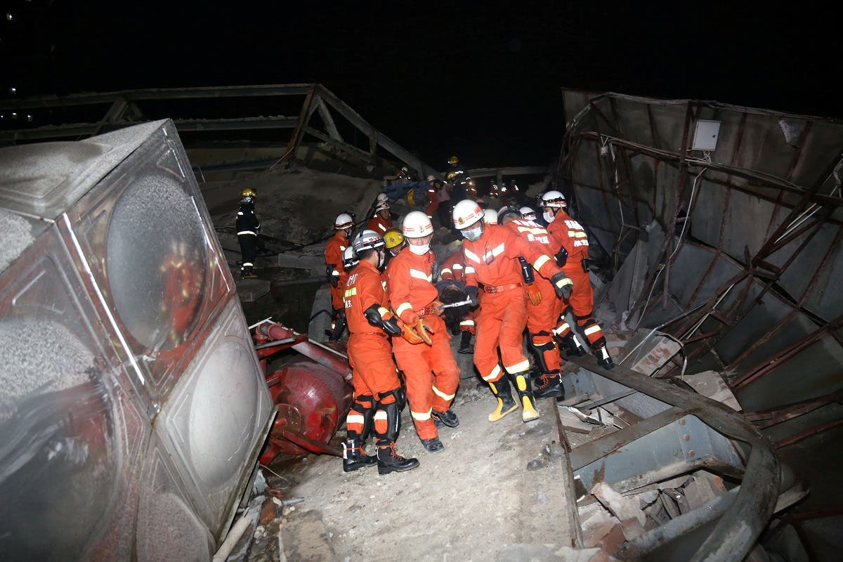 Rescue workers move casualty on the site where a hotel being used for the coronavirus quarantine collapsed, as the country is hit by the novel coronavirus, in the southeast Chinese port city of Quanzhou, Fujian province, China March 7, 2020. Picture taken March 7, 2020. (Reuters)