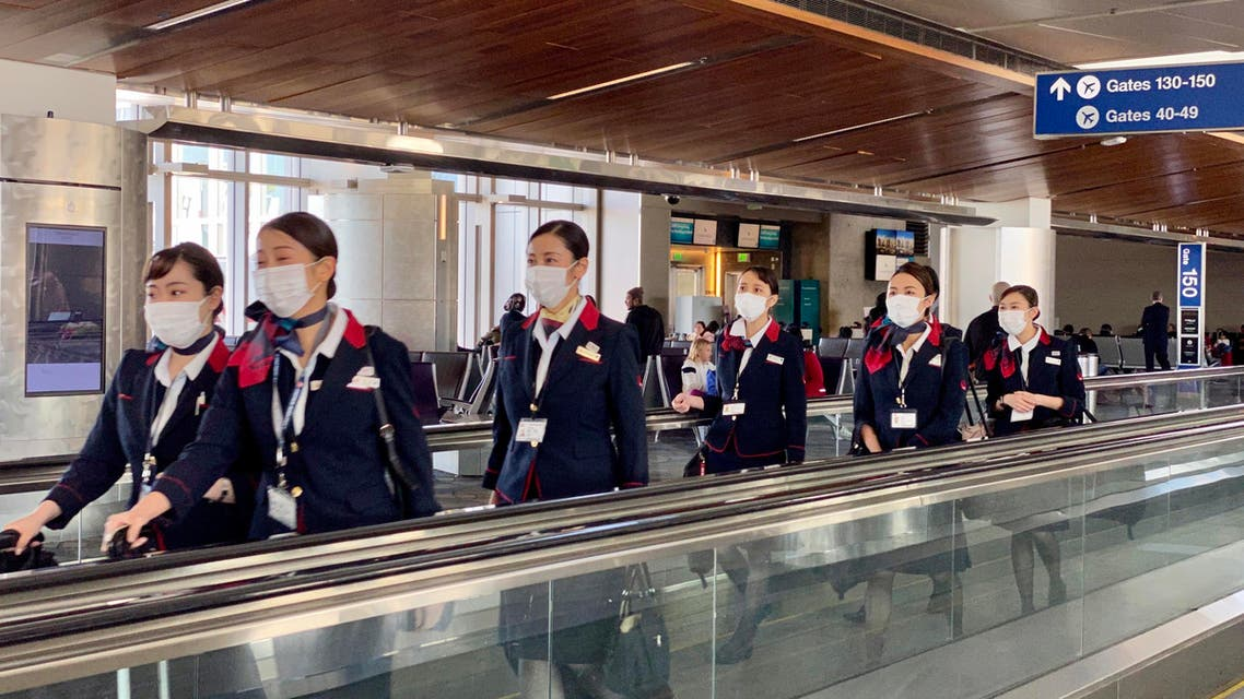 Japanese airline (JAL) crew are seen at Los Angeles International Airport (LAX) wearing masks, to prevent the coronavirus infection, on February 12, 2020. (AFP)