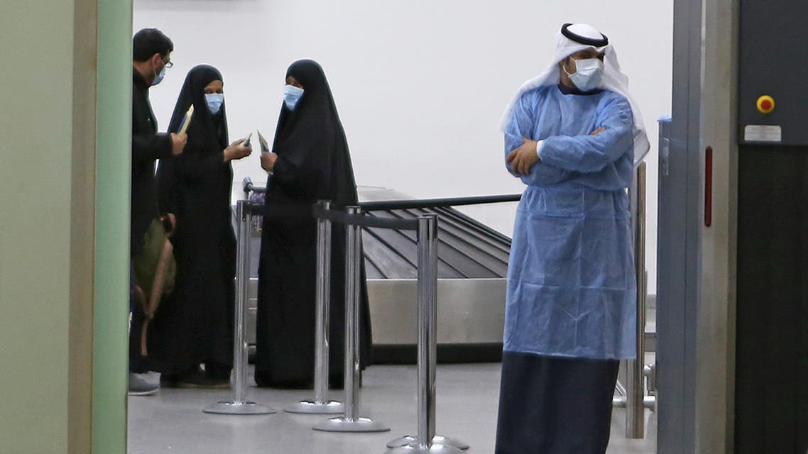 Kuwaitis coming back from Iran wait at Sheikh Saad Airport in Kuwait City, on February 22, 2020, before being taken to a hospital to be tested for coronavirus. (AP)