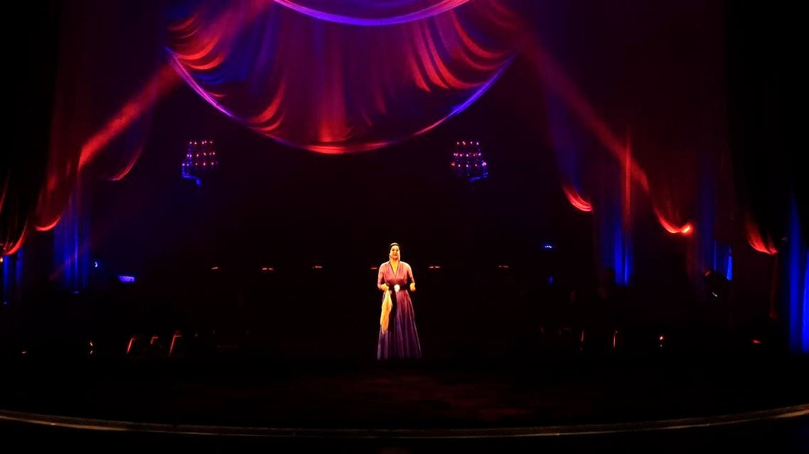 A hologram of legendary Egyptian singer Umm Kulthum is projected on stage at Cairo Opera House in Cairo, late on March 6, 2020, about 45 years after the singer's death. (AFP)