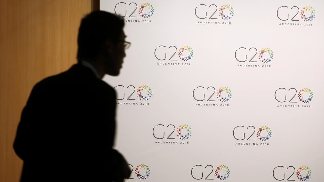 A man stands next to a board with the G20 Meeting of Finance Ministers logo in Buenos Aires, Argentina. (File photo: Reuters)