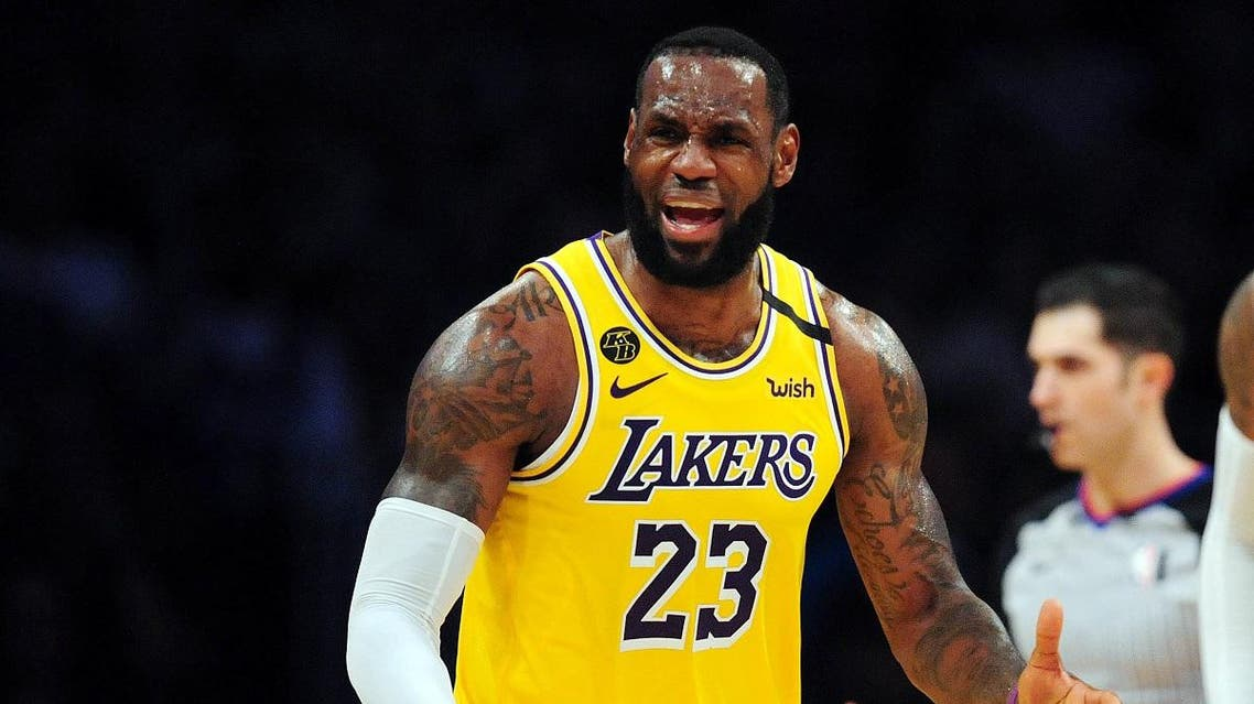 Los Angeles Lakers forward LeBron James (23) reacts against the Milwaukee Bucks during the second half at Staples Center. (Gary A. Vasquez/USA TODAY Sports)