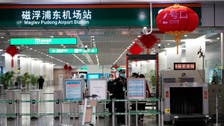 Shanghai tightens airport screening as imported coronavirus cases in China jump