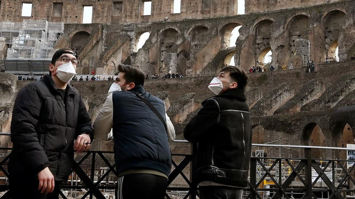 Tourists wearing respiratory masks visit the Coliseum in Rome on March 6, 2020. (AFP)