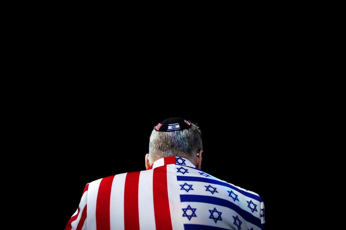 A member of the audience looks on wearing a United States-Israel themed custom suit during the AIPAC convention at the Washington Convention Center in Washington. (Reuters)