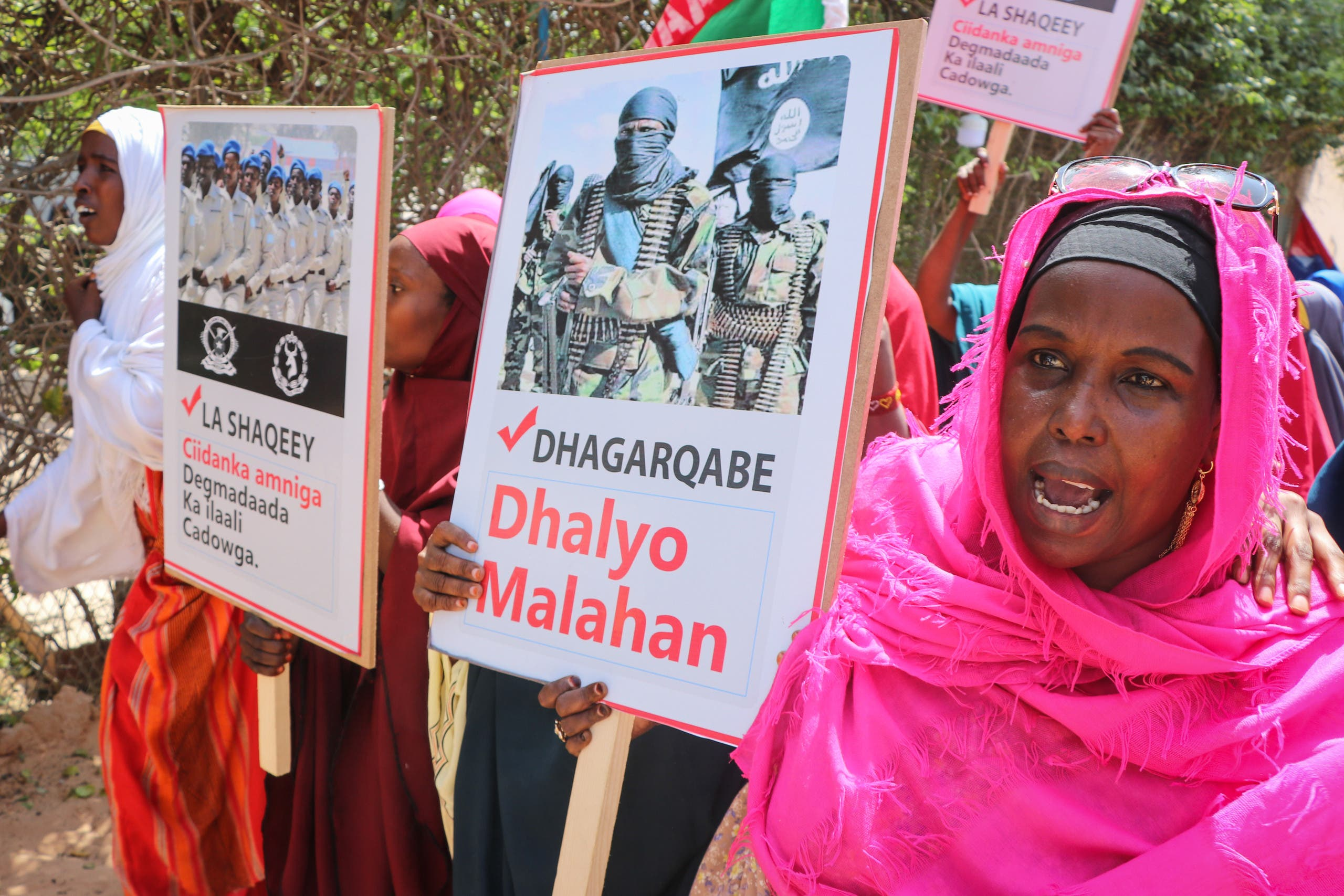 Somali women chant slogans and hold placards as they protest against Somali Islamist group al-Shabaab in Mogadishu on January 2, 2020. (AFP)