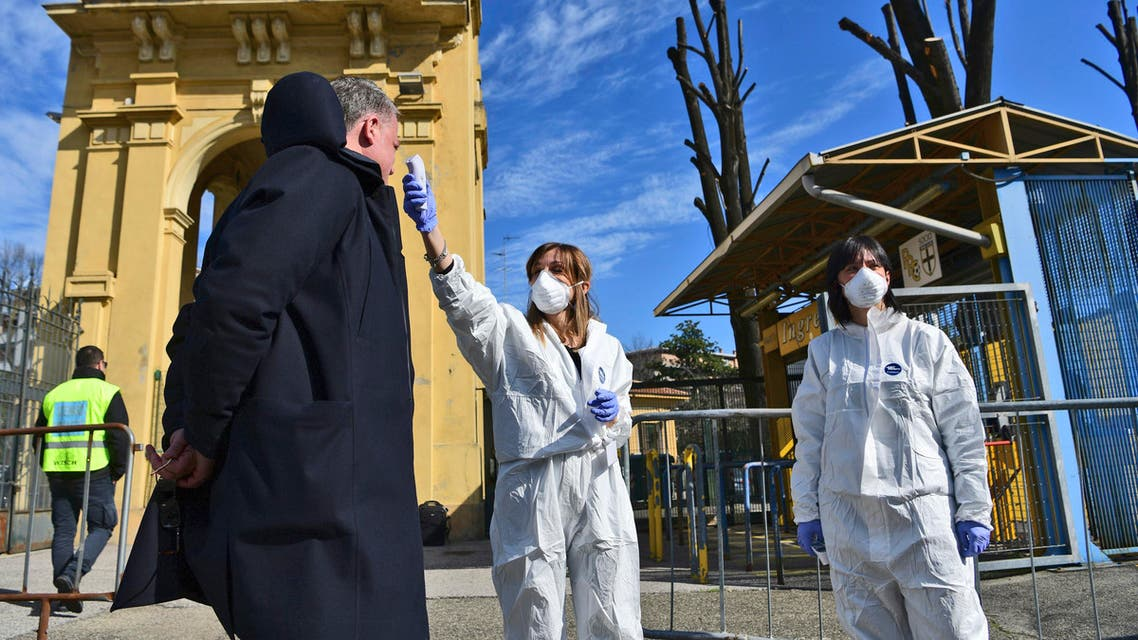 Medical personnel take the temperature of a man outside the Ennio Tardini stadium ahead of a Serie A soccer match in Parma on March 8, 2020. (AP)