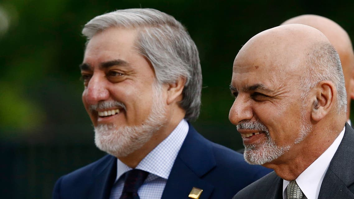 Afghanistan's President Ashraf Ghani (R) is pictured next to Afghanistan's Chief Executive Abdullah Abdullah as they arrive for the NATO Summit in Warsaw, Poland July 9, 2016. REUTERS/Kacper Pempel