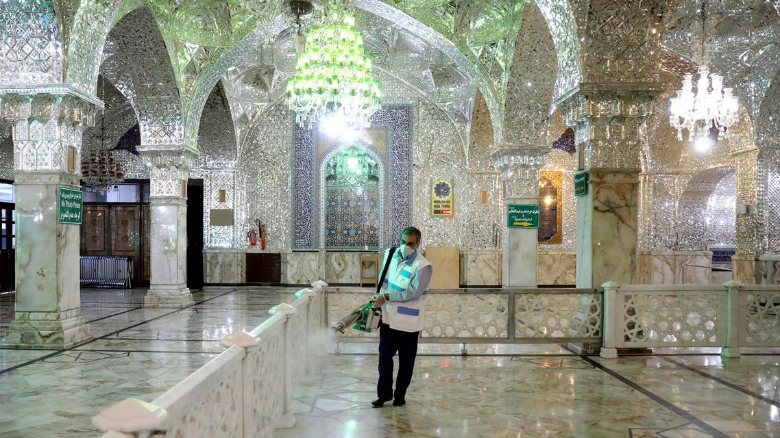 A man disinfects the shrine of the Shia Saint Imam Abdulazim to help prevent the spread of the new coronavirus in Shahr-e-Ray, south of Tehran on March, 7, 2020. (AP)