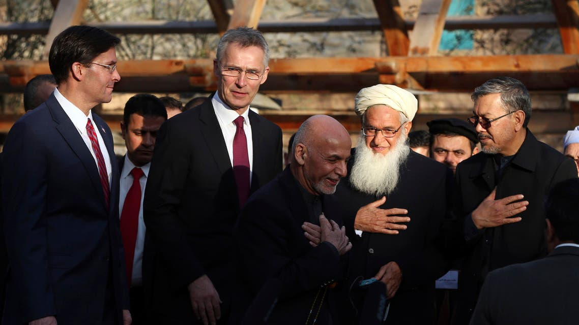 Afghan President Ashraf Ghani, center, arrives with NATO Secretary General Jens Stoltenberg, and U.S. Secretary of Defense Mark Esper for a joint news conference in presidential palace in Kabul (AP)