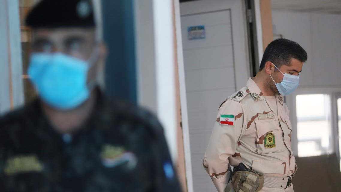 A member of Iranian Border Guards wears a protective face mask, following an outbreak of the new coronavirus, inside the Shalamcha Border Crossing, after Iraq shut a border crossing to travellers between Iraq and Iran, Iraq March 8, 2020. REUTERS/Essam al-Sudani