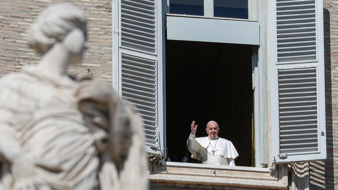 Pope Francis waves briefly from his window after delivering the Angelus prayer at the Vatican on March 8, 2020. (AP)