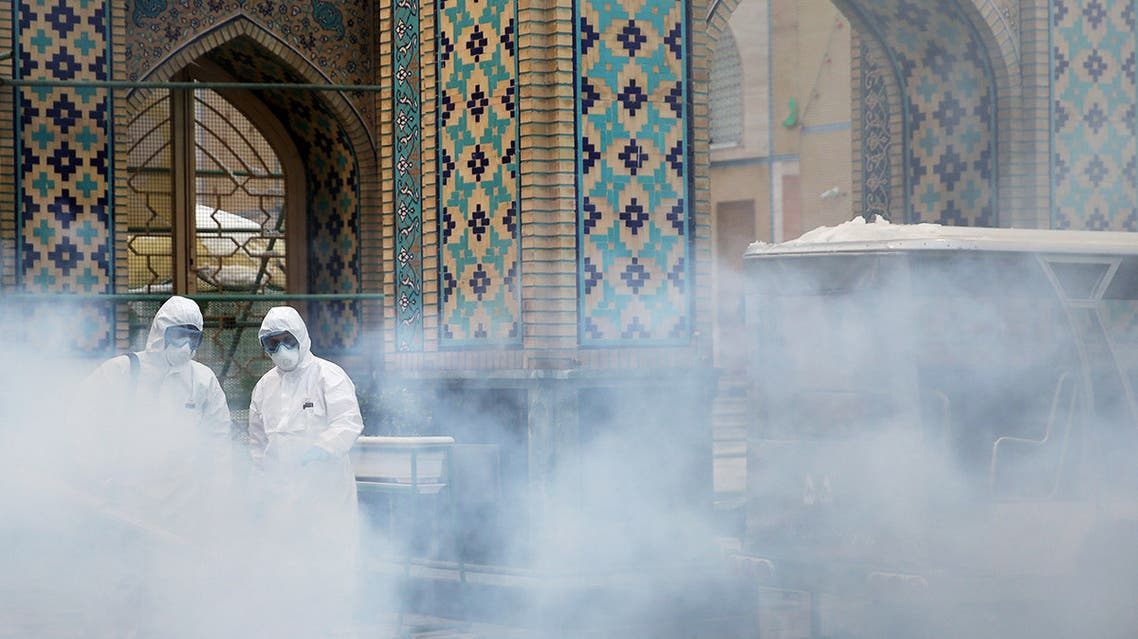 Members of the medical team spray disinfectant to sanitize outdoor place of Imam Reza's holy shrine, following the coronavirus outbreak, in Mashhad, Iran February 27, 2020. Picture taken February 27, 2020. WANA (West Asia News Agency) via REUTERS ATTENTION EDITORS - THIS PICTURE WAS PROVIDED BY A THIRD PARTY