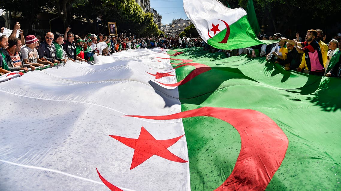 Algerian protesters march with a giant national flag during a demonstration in the capital Algiers on May 31, 2019. (AFP)