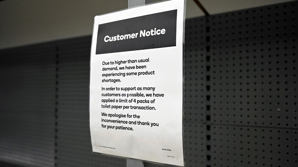 A notice placed next to empty shelves after customers stocked up on toilet paper amid coronavirus fears, is seen in a grocery store in Sydney, Australia, March 6, 2020. (Reuters)