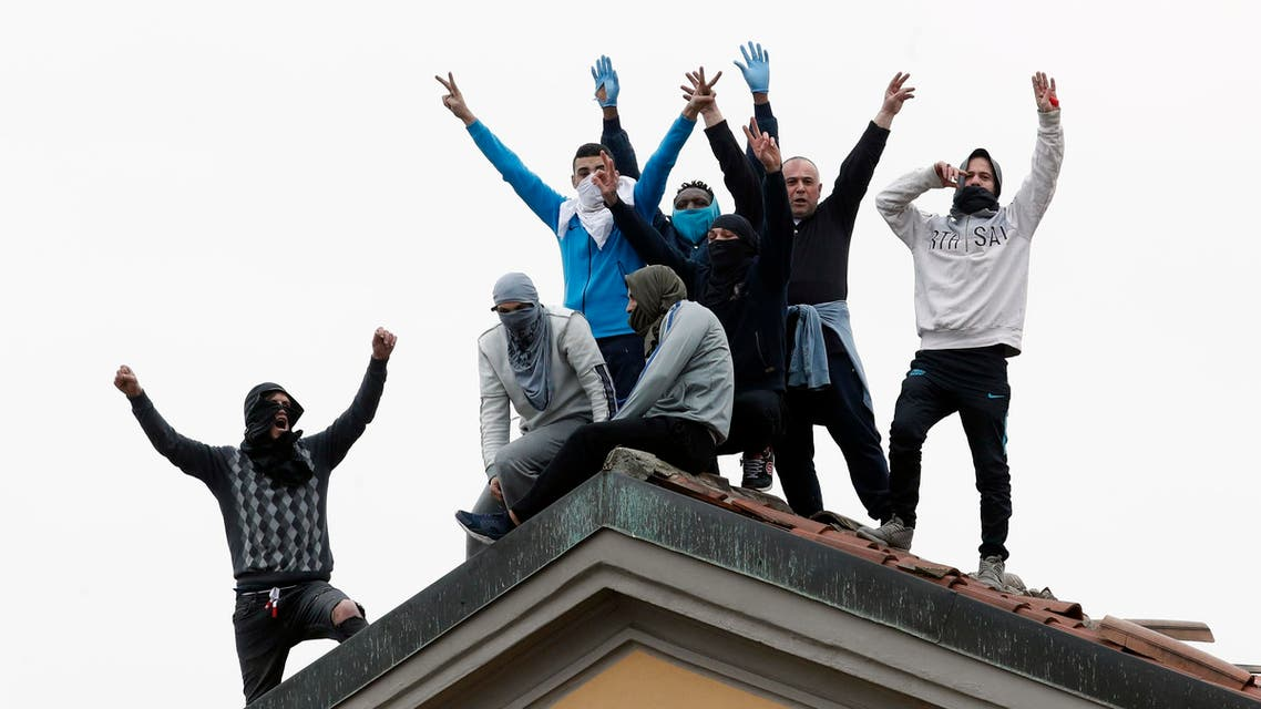 Inmates stage a protest against new rules to cope with coronavirus emergency on the roof of the San Vittore prison in Milan on March 9, 2020. (AP)