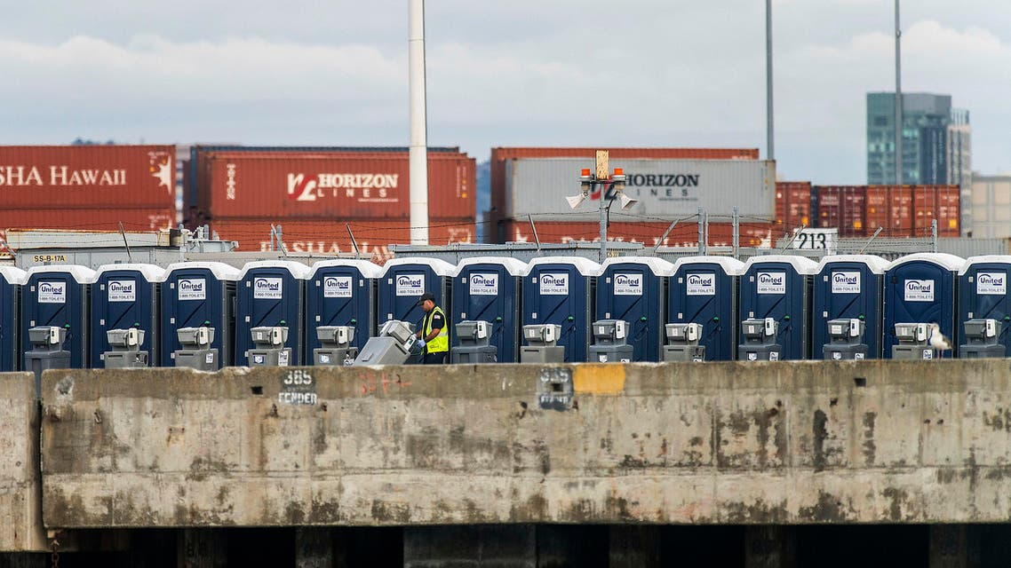 A worker prepares a wharf at the Port of Oakland to receive the cruise ship Grand Princess in Oakland, California on Sunday, March 8, 2020. (AP)