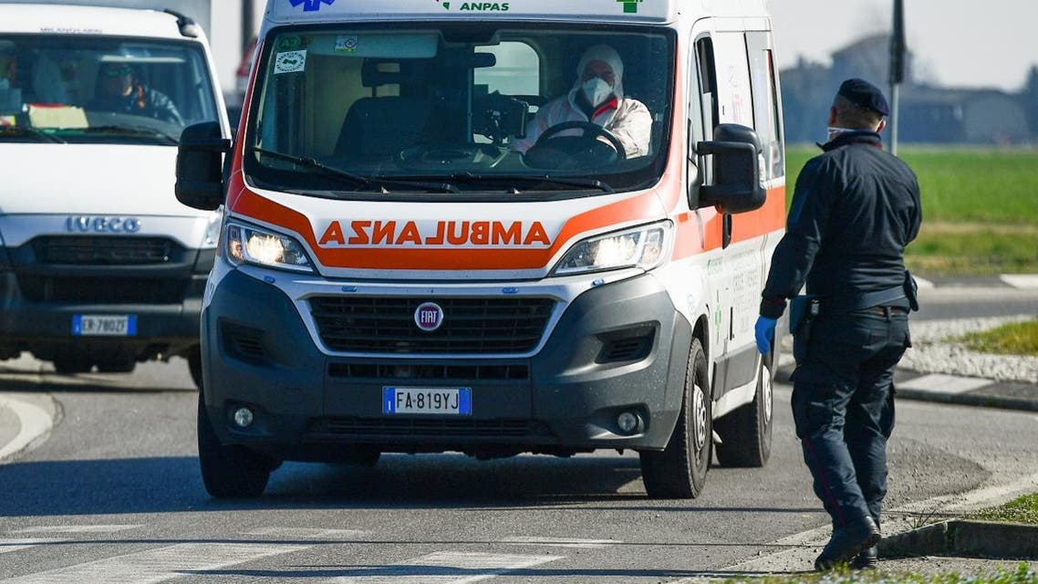 An ambulance drives past a police check-point few kilometers from the small town of Castiglione d'Adda, southeast of Milan, on February 24, 2020. (AFP)
