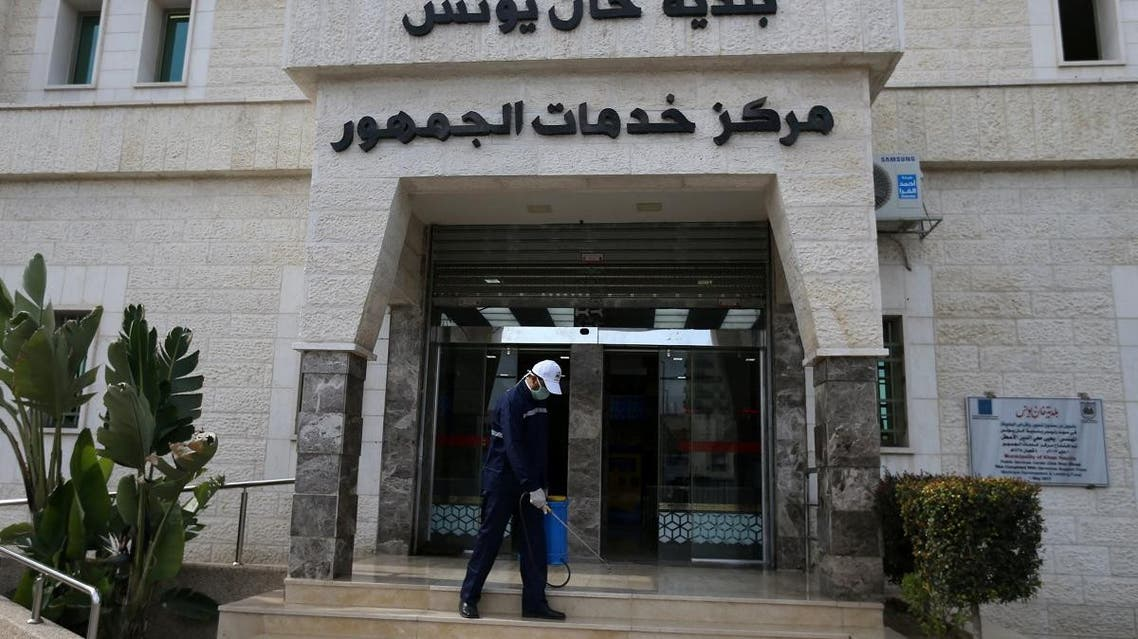 A Palestinian worker sprays disinfectants at Khan Younis municipality office amid coronavirus precautions, in Khan Younis in the southern Gaza Strip March 9, 2020. (Reuters)