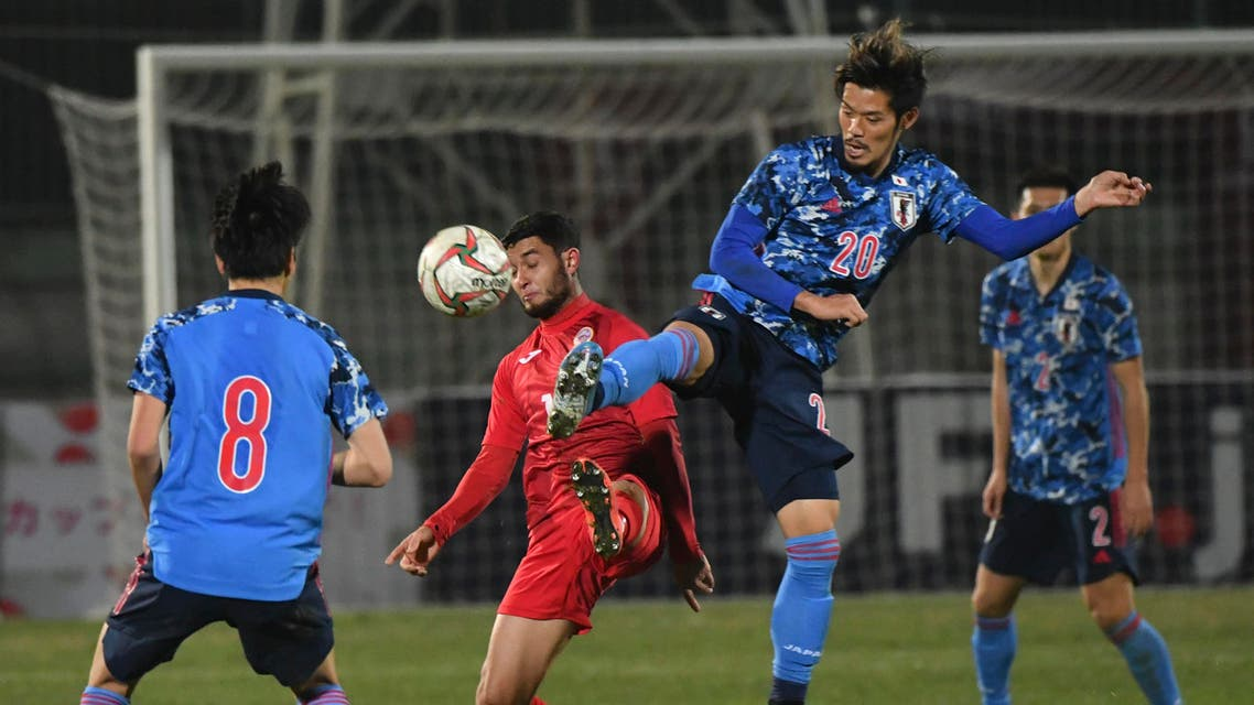 Japan's Yamaguchi Hotaru, right, fights for the ball with Kyrgyzstan's player during the World Cup 2022 Qualifying Asian zone Group F soccer match in Bishkek, Kyrgyzstan on Nov. 14, 2019. (AP)