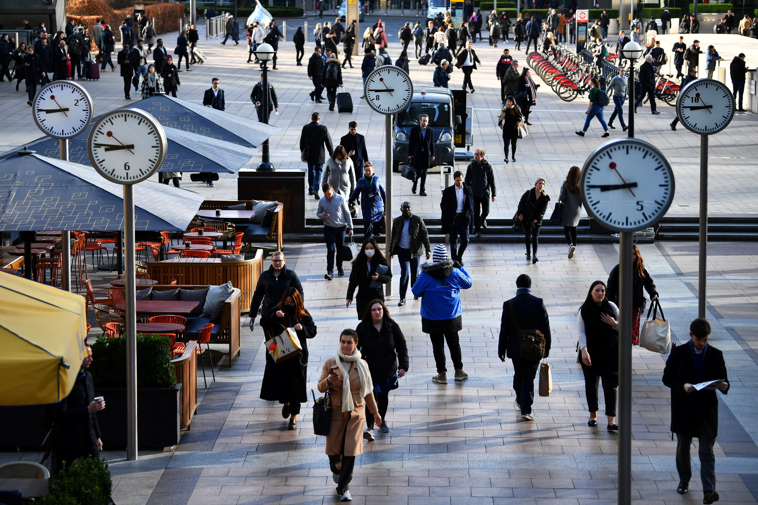 Commuters walk through Canary Wharf, as the number of coronavirus cases grow around the world and as European stocks plunge into bear market territory, in London, Britain March 9, 2020. (Reuters)