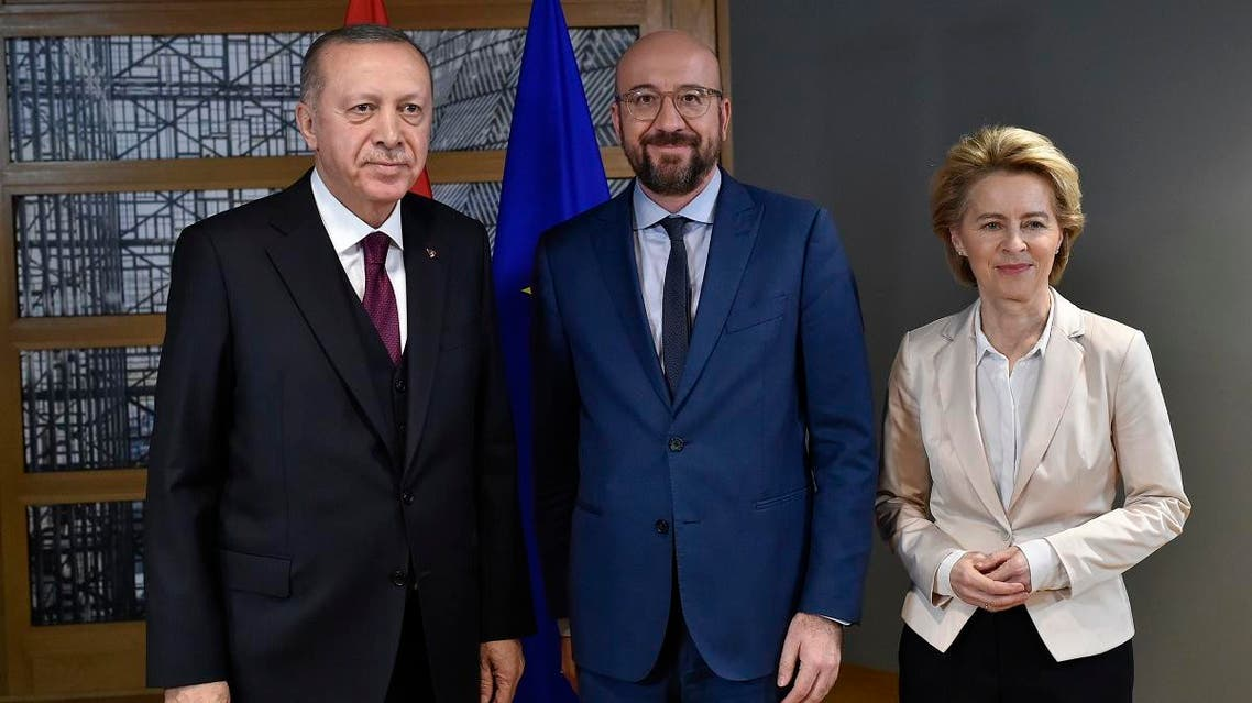 EU Council President Charles Michel (C) and European Commission President Ursula von der Leyen (R) pose with Turkish President Erdogan (L) before their meeting at the EU headquarters in Brussels on March 9, 2020. (AFP)