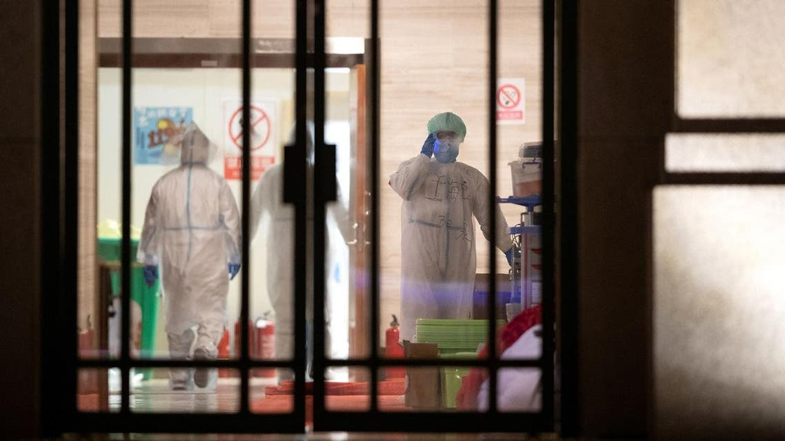 Medical staff in protective suits are seen inside a makeshift hospital that is closed following its last group of patients of the novel coronavirus have been discharged, in Wuhan, the epicentre of the novel coronavirus outbreak, in Hubei province, China March 1, 2020. (Reuters)