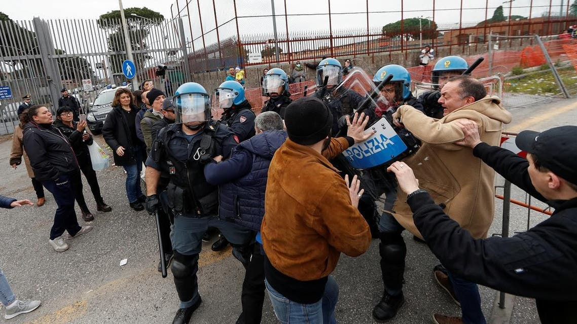 Relatives of inmates clash with police outside of Rebibbia Prison during a prisoners' revolt, after family visits were suspended due to fears over coronavirus contagion, in Rome, Italy March 9, 2020. (Reuters)