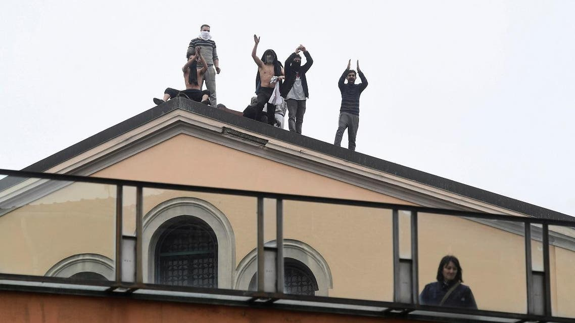Inmates are seen on the roof of the San Vittore Prison during a revolt after family visits were suspended due to fears over coronavirus contagion, in Milan, Italy March 9, 2020. (Reuters)
