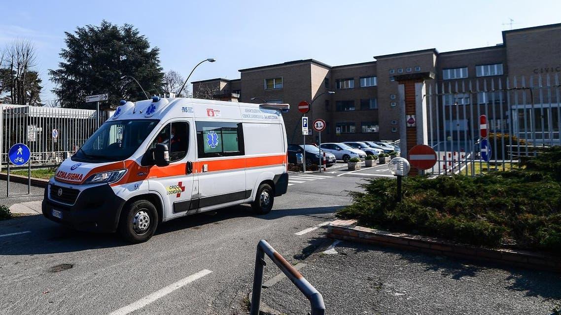 An ambulance leaves the municipal hospital in Codogno, southeast of Milan, on February 22, 2020. (AFP)