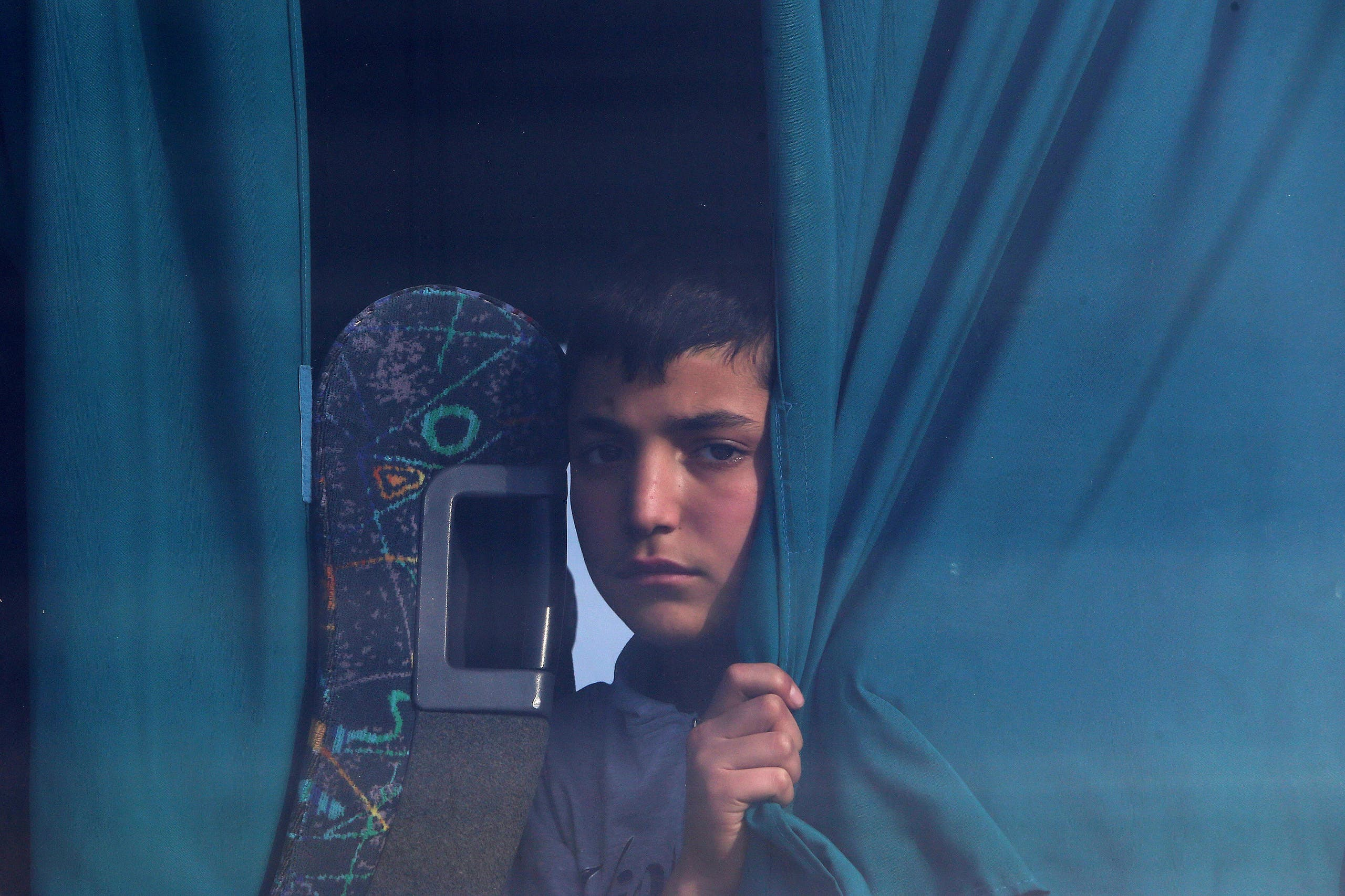 A boy migrant from Syria sits in a bus in the eastern Mediterranean island of Cyprus, on Feb. 4, 2017. (AP)