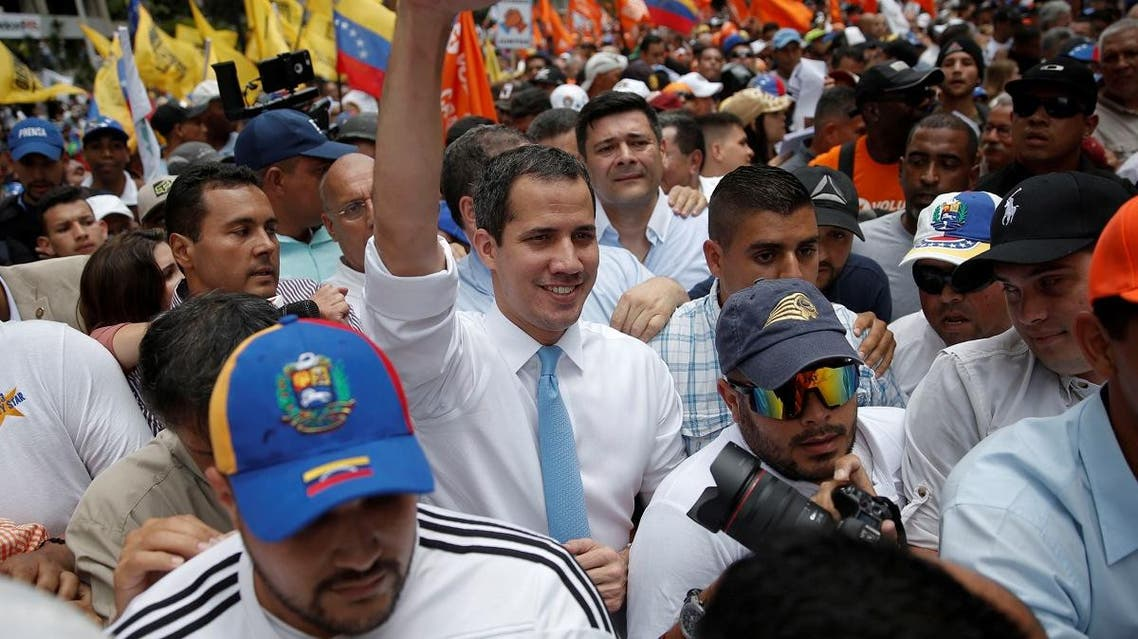 Venezuela's National Assembly President and opposition leader Juan Guaido rises an arm as he takes part in a demonstration in Caracas, Venezuela March 10, 2020. (Reuters)
