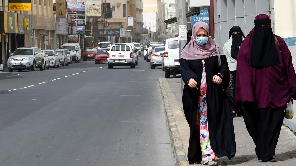 People wearing masks seen in the heart of the Bahraini capital Manama on February 26, 2020. (AFP)