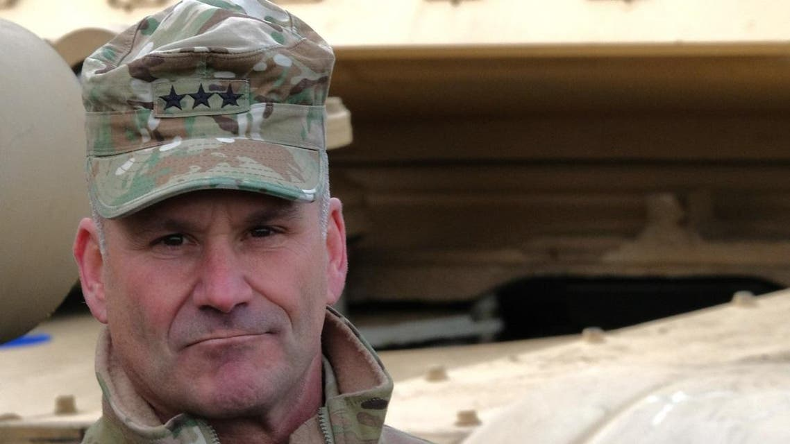 US army's Lieutenant General Christopher G. Cavoli, who commands the United States Army Europe (USAREUR), attends the unloading operation of US military equipment of the 2nd Brigade Combat Team, 3rd Infantry Division, ahead of the Defender 2020 international military exercises at the Port of Bremerhaven on February 21, 2020. (AFP)