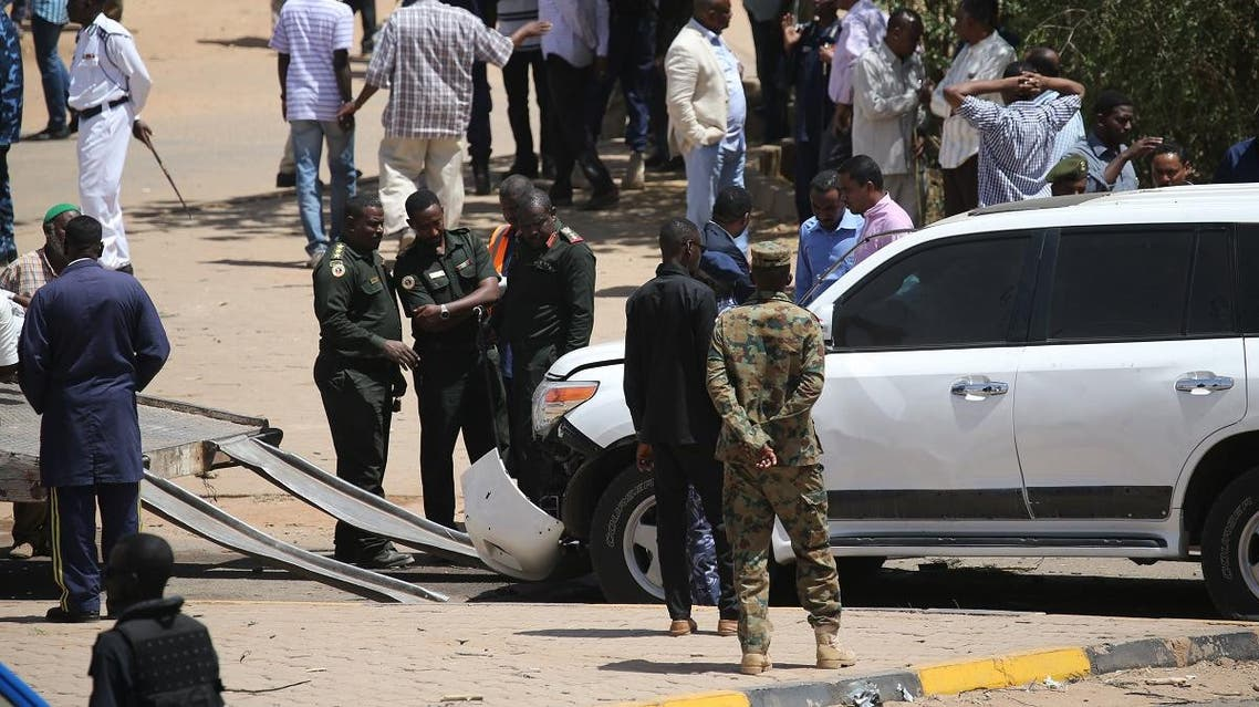 Security forces gather next to a damaged vehicle at the site of an assassination attempt against Sudan's Prime Minister Abdalla Hamdok, who survived the attack with explosives unharmed, in the capital Khartoum on March 9, 2020. (AFP)