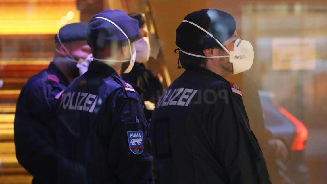 Police officers wear protective masks as they close a hotel near the city centre in Innsbruck, Austria, on February 25, 2020 after a woman who worked here has been confirmed infected with the coronavirus. (AFP)